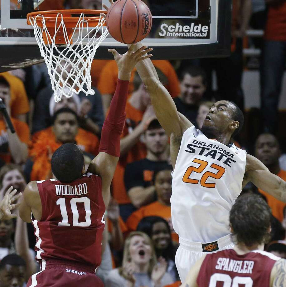 "Oklahoma and Jordan Woodard (left) swept the regular-season ""Bedlam"" series from in-state rival Oklahoma State and Markel Brown. Photo: Sue Ogrocki / Associated Press / AP"