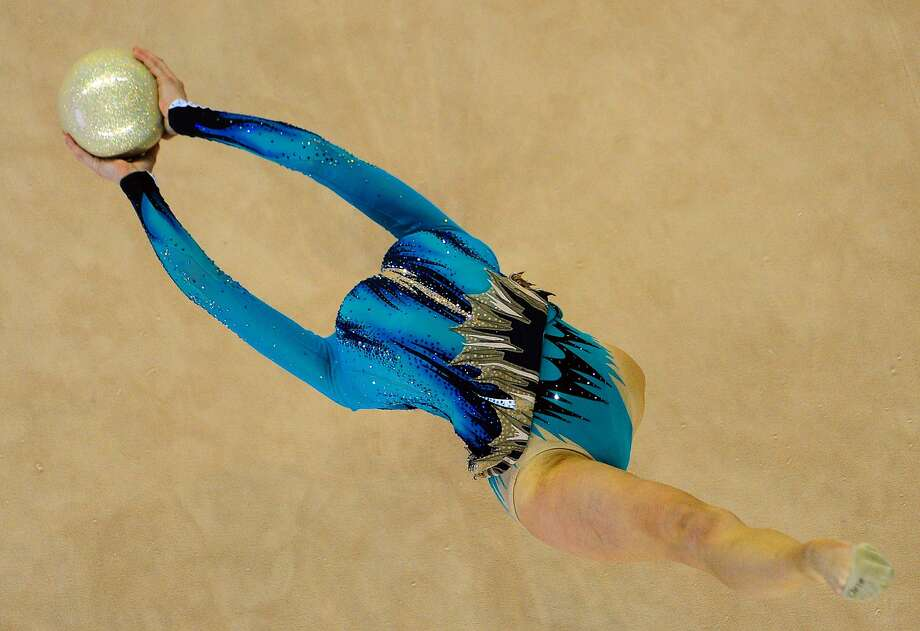 Medalist in the making:Katsiaryna Halkina of Belarus performs with a ball during the individual final of the Rhythmic Gymnastics World Cup in Debrecen, Hungary. Halkina won bronze. Photo: Attila Kisbenedek, AFP/Getty Images