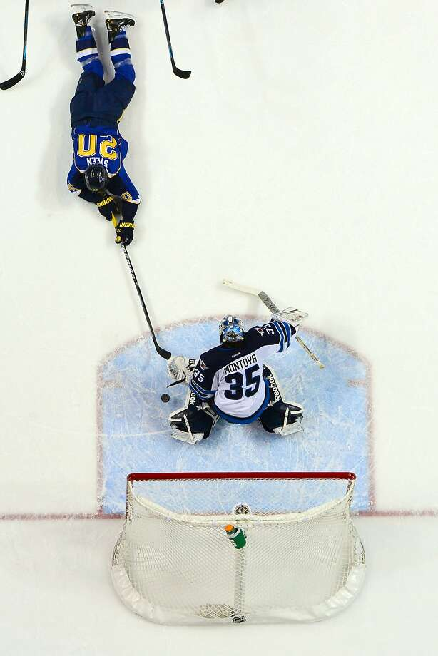 Mar 17, 2014; St. Louis, MO, USA; Winnipeg Jets goalie Al Montoya (35) blocks the shot of St. Louis Blues left wing Alexander Steen (20) during the second period at Scottrade Center. The St. Louis Blues defeat the Winnipeg Jets 4-1. Mandatory Credit: Jasen Vinlove-USA TODAY Sports Photo: Jasen Vinlove, Reuters