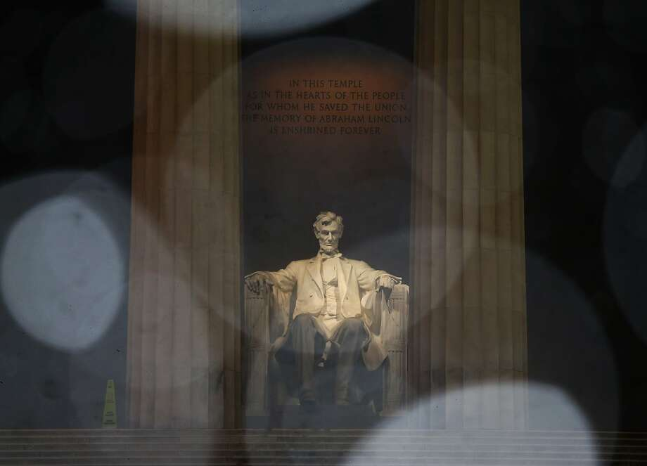 WASHINGTON, DC - MARCH 17:  Snow falls in front of the Lincoln Memorial, on March 17, 2014 in Washington, DC. The Washington area was hit with a over night snow storm leaving 5 to 7 inches of snow in some areas.  (Photo by Mark Wilson/Getty Images) Photo: Mark Wilson, Getty Images
