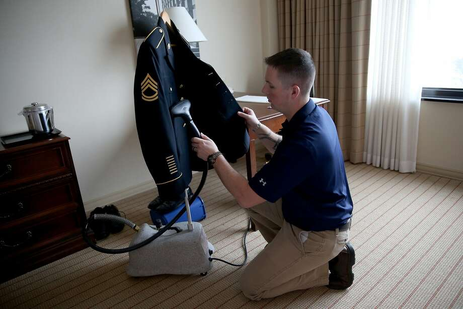 WASHINGTON, DC - MARCH 17:  U.S. Army Staff Sergeant Christopher Schneider, from U.S. Army Old Guard, 3d U.S. Infantry Regiment, irons the military uniform of U.S. Army Staff Sergeant Melvin Morris, a Vietnam War veteran, as he prepares it for his visit to the White House on March 17, 2014 in Washington,DC. Melvin Morris and two others are the only living soldiers who will be honored with 21 others on March 18th, 2014 at the White House by President Barack Obama with the Medal of Honor for conspicuous gallantry. Following a congressionally mandated review to ensure that eligible recipients were not bypassed due to prejudice the veterans will receive the Medal of Honor for action during major combat operations in World War II, the Korean War and the Vietnam War.  (Photo by Joe Raedle/Getty Images) Photo: Joe Raedle, Getty Images