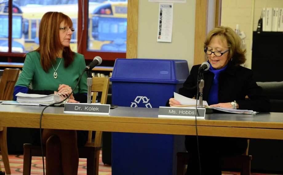 Board of Education Chairman Hazel Hobbs, right, thanks Superintendent of Schools Mary Kolek, left, during a March 17, 2014, special meeting, for her 10 years of service to the New Canaan Public Schools. Photo: Nelson Oliveira / New Canaan News