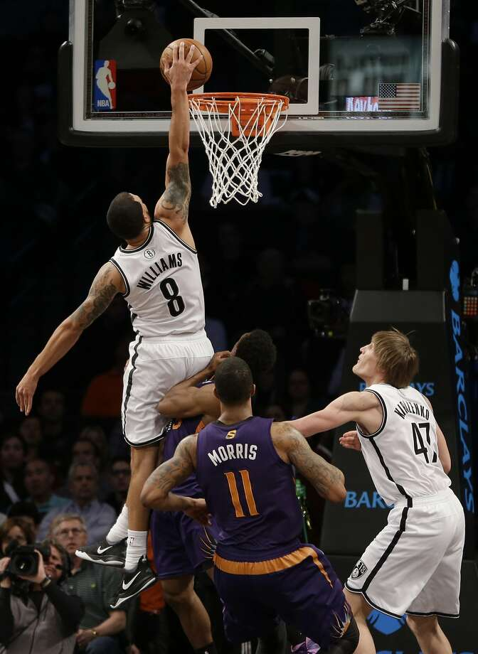 The Nets' Deron Williams finishes a fourth-quarter fast break with his first dunk of the season. Photo: Seth Wenig, Associated Press