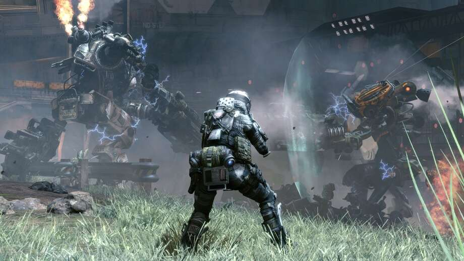 "In the video game, ""Titanfall,"" players can pilot mechs or have their Titan follow them on the battlefield. Photo: EA"