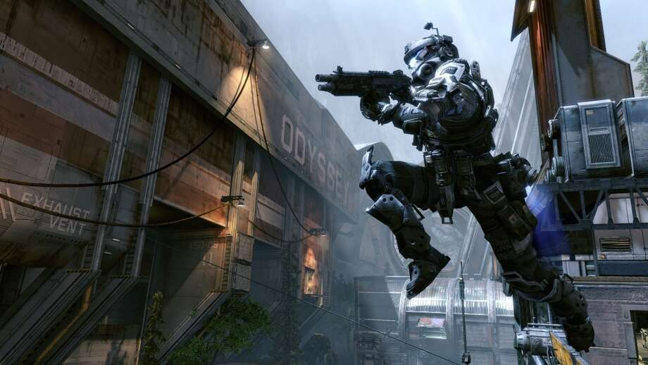 "In the video game, ""Titanfall,"" players can jump and run across walls via jump packs. Photo: EA"