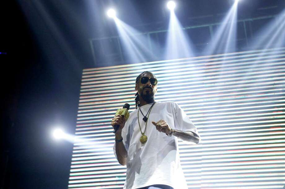 Rapper Snoop Dog performs at a discotheque in the resort city of Cancun, Mexico, Thursday March 13, 2014. Snoop Dog offered a concert as part of the activities in this city for this year's spring break season. Although violence in some border cities has quelled, spring breakers remain hesitant to take any chances in Mexico this year. While more Americans are returning to popular destinations such as Mexico City, Cancun and Los Cabos, the border communities have yet to see significant rebounds. Photo: Israel Leal, AP / AP