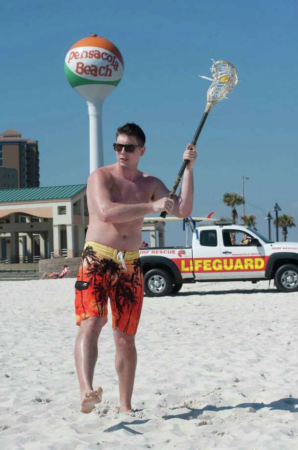 Virginia Tech spring breaker Matthew Meeder gets in a little recreation in the sun at Pensacola Beach in Pensacola, Fla.  on Monday, March 10, 2014. Meeder is visiting the area with his sister University of South Carolina student Michelle Meeder. (AP Photo/The Pensacola News Journal, Tony Giberson)  Photo: Tony Giberson, AP / The Pensacola News Journal