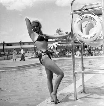 The more things change, the more they stay the same. Here, film actor and sex symbol Jayne Mansfield (1933 - 1967) poses in a bikini by a lifeguard chair at the Dunes Hotel, Las Vegas, mid-1950s. Photo: Hulton Archive, Getty / 2004 Getty Images
