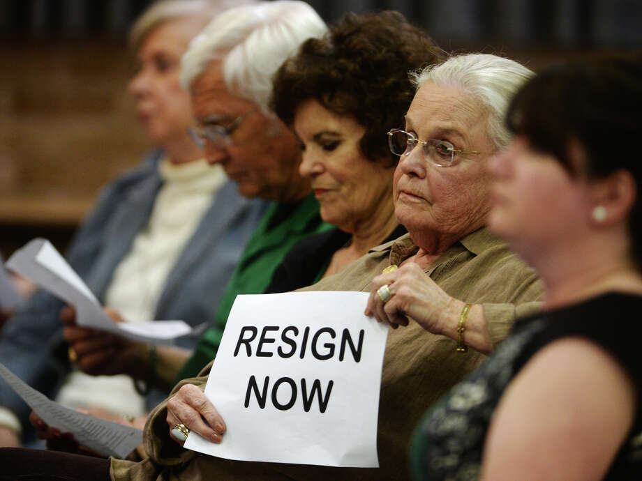 Lynne DeCordova holds a sign calling for Superintendent Dr. Timothy Chargois' resignation Monday. The Beaumont Independent School District's board of trustees met Monday night. Photo taken Monday, 3/17/14 Jake Daniels/@JakeD_in_SETX Photo: Jake Daniels / ©2014 The Beaumont Enterprise/Jake Daniels