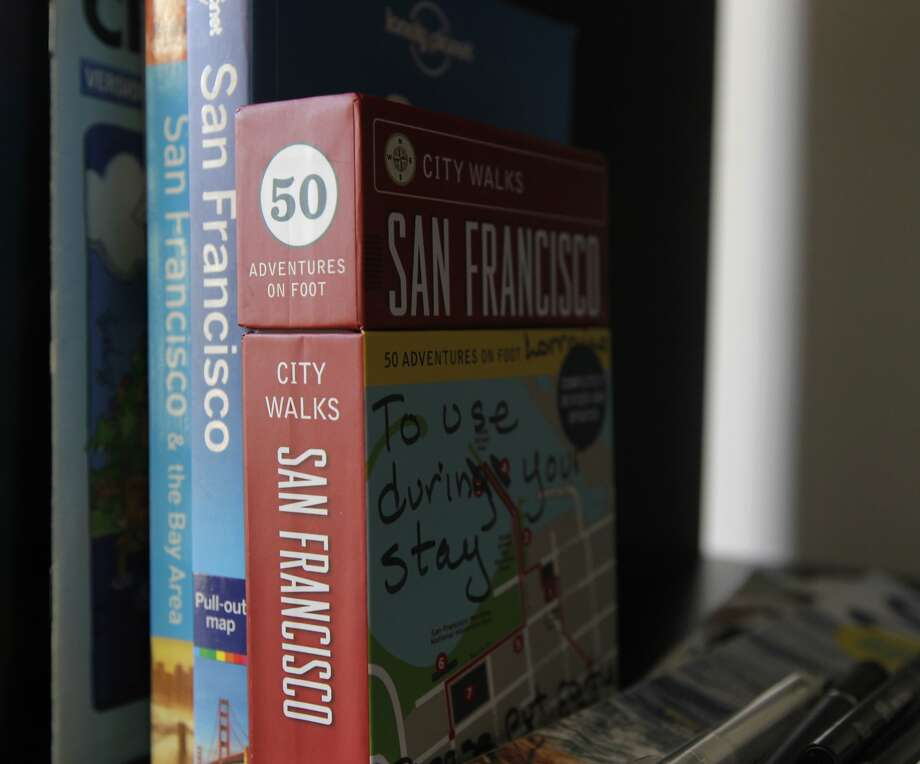 Local guidebooks and other information are available for overnight guests renting a room at a home in San Francisco. Photo: Paul Chinn, The Chronicle