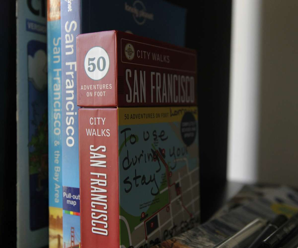 Local guidebooks and information are available for overnight guests renting a room at Lorraine Rorke Bader's home in San Francisco, Calif. on Saturday, Jan. 25, 2014. Bader rents out the room, with a 3-night minimum stay, for $120 a day using the Airbnb service.