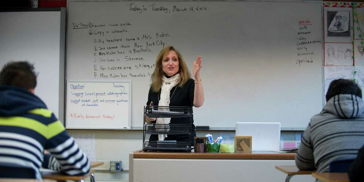 Jeannie Kahn teaches an acculturation class at Danbury High School, Danbury, Conn, on Tuesday, March 18, 2014. The class is for newcomers to the United States, from other countries, with limited English proficiency.