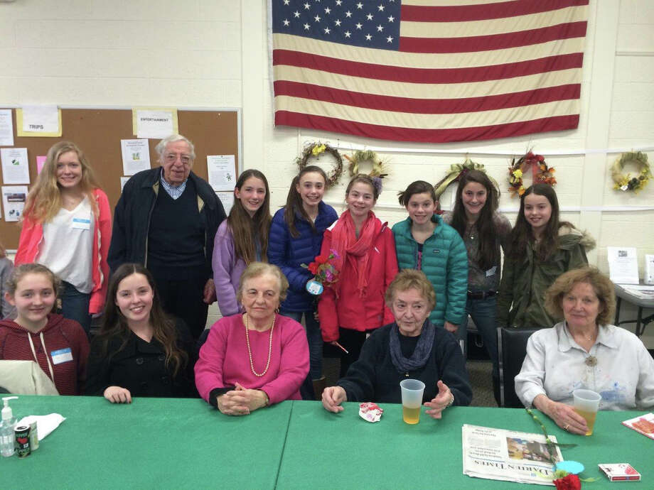 Members of ìYî Cares Club recently visited with seniors at the Darien Senior Center where they spent time solving brain teasers. Photo: Contributed Photo, Contributed / Darien News Contributed