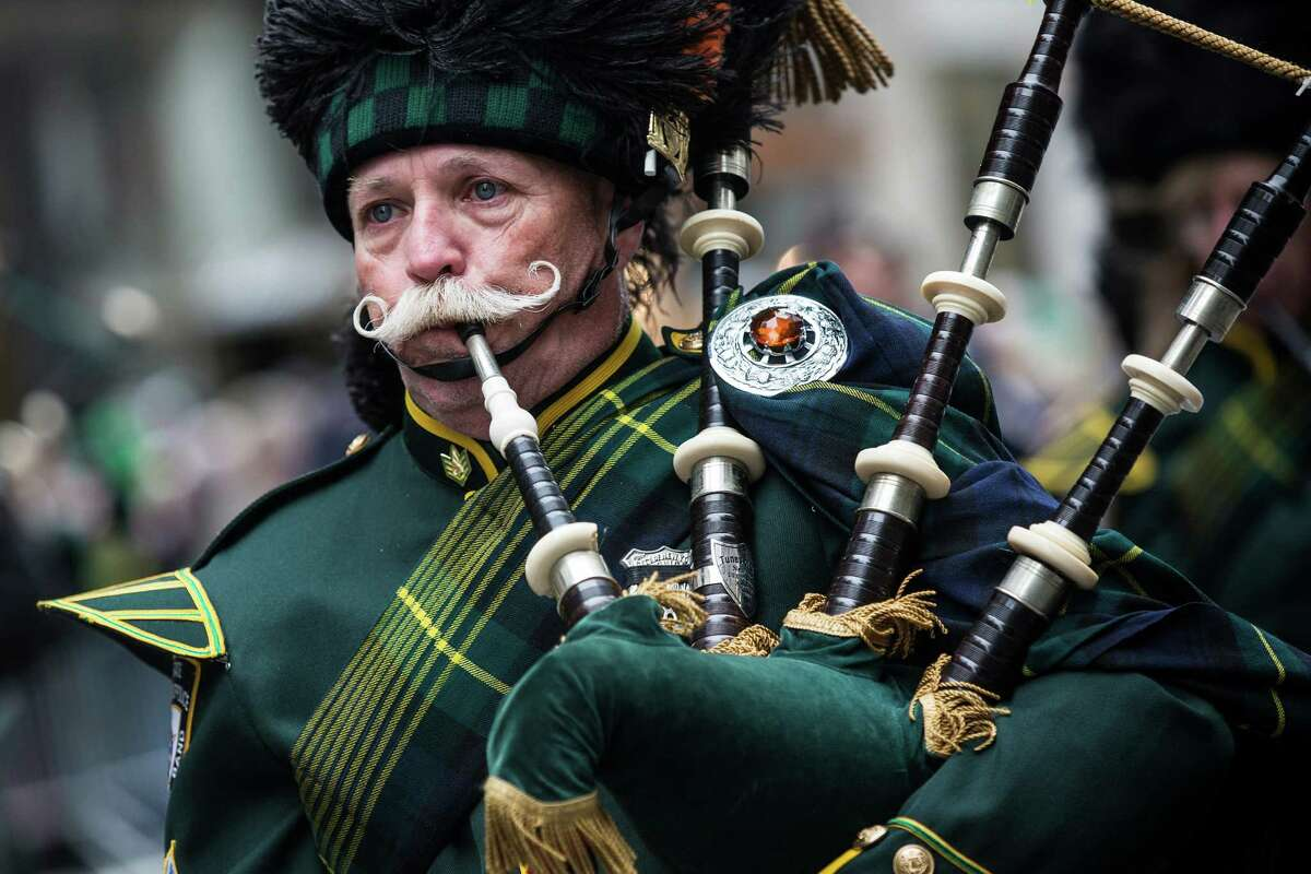 NEW YORK, NY - MARCH 17: A bagpiper marches in the annual St. Patrick's Day Parade along Fifth Ave in Manhattan on March 17, 2014 in New York City. Political controversy surrounded this year's parade, as New York City Mayor Bill De Blasio decided not to march due to the parade organizer's policy to ban participants that identify themselves as lesbian, gay, bisexual or transgender. Heineken and Guinness announced earlier that they would drop their sponsorship of the parade for along the same reasons. (Photo by Andrew Burton/Getty Images) *** BESTPIX *** ORG XMIT: 479153251