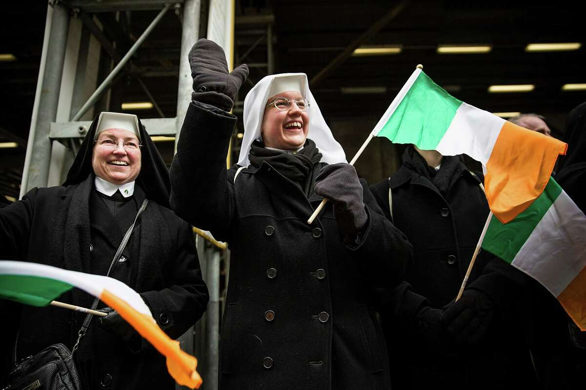 NEW YORK, NY - MARCH 17: A group of nuns watch the annual St. Patrick's Day Parade along Fifth Ave in Manhattan on March 17, 2014 in New York City. Political controversy surrounded this year's parade, as New York City Mayor Bill De Blasio decided not to march due to the parade organizer's policy to ban participants that identify themselves as lesbian, gay, bisexual or transgender. Heineken and Guinness announced earlier that they would drop their sponsorship of the parade for along the same reasons. (Photo by Andrew Burton/Getty Images) ORG XMIT: 479153251