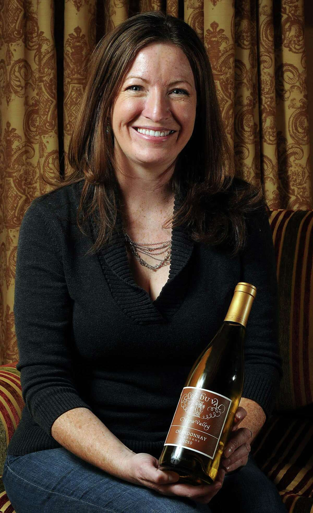 Kristy Melton, a winemaker for Clos du Val, with their 2010 Chardonnay Carneros Wednesday Jan 15 2014.(Dave Rossman photo)