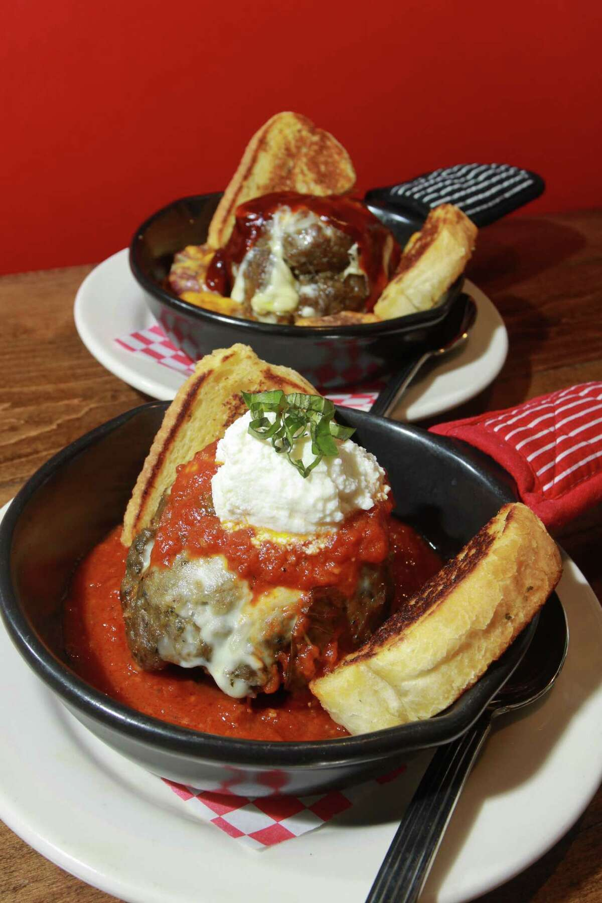 (For the Chronicle/Gary Fountain, March 13, 2014) The City Oven Meatball, foreground, with a Texas Chipotle Meatball in the background, at City Oven.