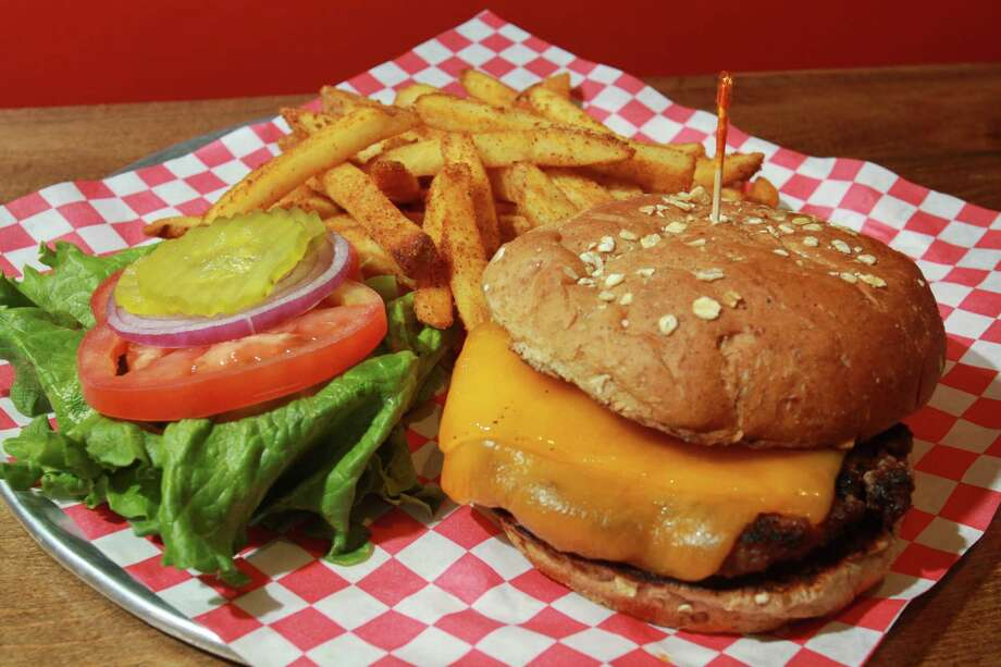 Burgers, served with fresh-cut fries, are City Oven's saving grace. Photo: Gary Fountain, Freelance / Copyright 2014 by Gary Fountain