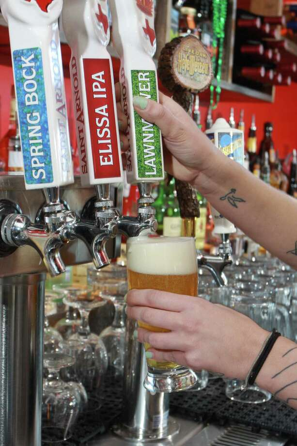 Bartender Kailey Davidowich pouring one of the local and craft beers on tap at City Oven. Photo: Gary Fountain, Freelance / Copyright 2014 by Gary Fountain