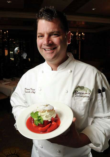 Chef Danny Trace with the strawberry shortcake at Brennan's restaurant Wednesday  March 12, 2014.(Dave Rossman photo) Photo: Dave Rossman, Freelance / Freelance