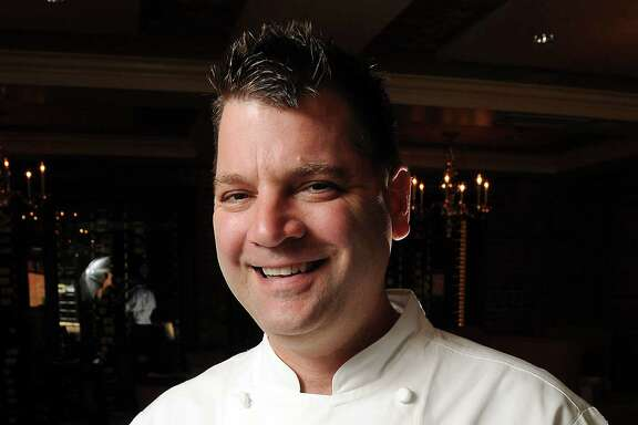 Chef Danny Trace with the strawberry shortcake at Brennan's restaurant Wednesday  March 12, 2014.(Dave Rossman photo)