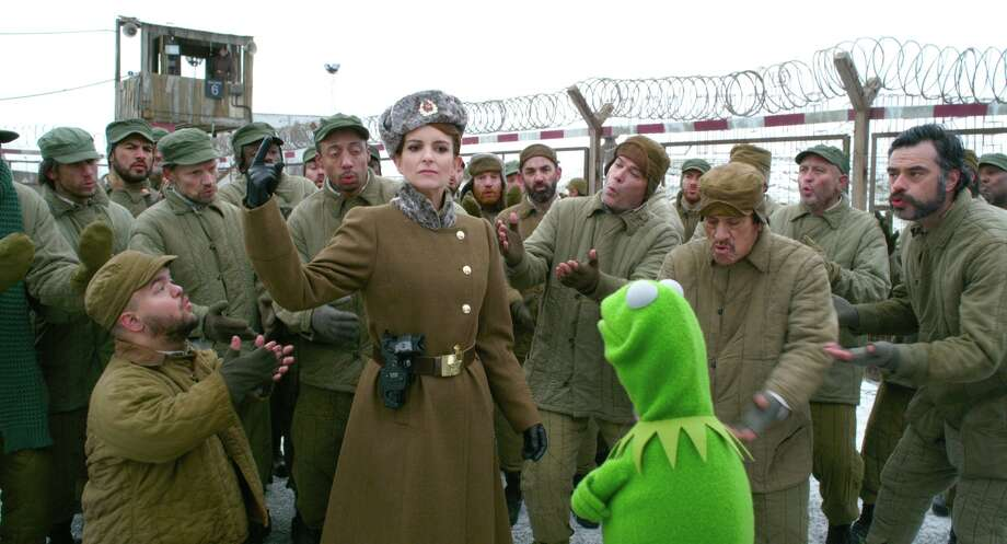 "Tina Fey keeps Kermit in the gulag in ""Muppets Most Wanted."" Photo: Disney / ©2013 Disney Enterprises, Inc. All Rights Reserved."