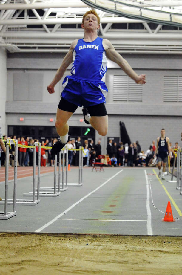 Darien's Nicholas Lombardo competes in the long jump event during FCIAC Indoor Track and Field Championships in New Haven on Thursday January 18, 2013. Photo: Christian Abraham / Connecticut Post