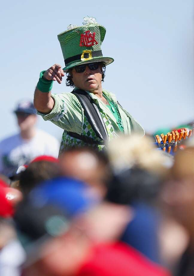 A beer vendor takes an order in the stands in the fourth inning of a spring training baseball game between the Los Angeles Angels and the San Francisco Giants, Monday, March 17, 2014, in Tempe, Ariz. Photo: Ross D. Franklin, Associated Press