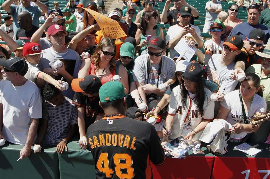 San Francisco Giants' Pablo Sandoval signs autographs prior to a spring training baseball game against the Los Angeles Angels, Monday, March 17, 2014, in Tempe, Ariz. Photo: Ross D. Franklin, Associated Press