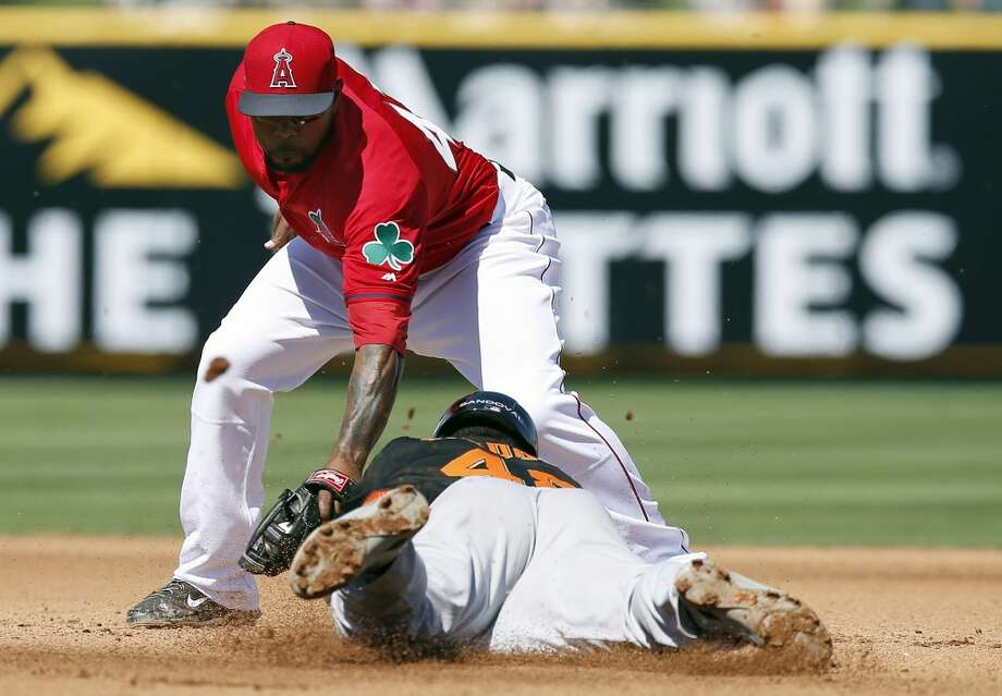 Los Angeles Angels' Howie Kendrick, left, tags San Francisco Giants' Pablo Sandoval, right, out at second base as Sandoval attempts to steal the base in the fourth inning of a spring training baseball game, Monday, March 17, 2014, in Tempe, Ariz. Photo: Ross D. Franklin, Associated Press