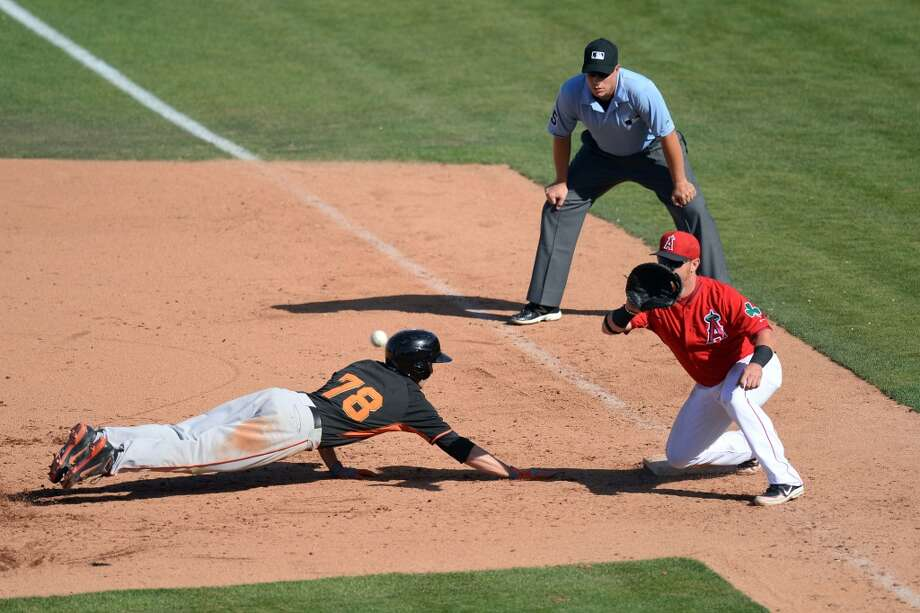 San Francisco Giants Tyler Graham (78) dives back into first base after a pickoff attempt against the San Francisco Giants at Tempe Diablo Stadium. The Angles won 8-7. Photo: Joe Camporeale, Reuters