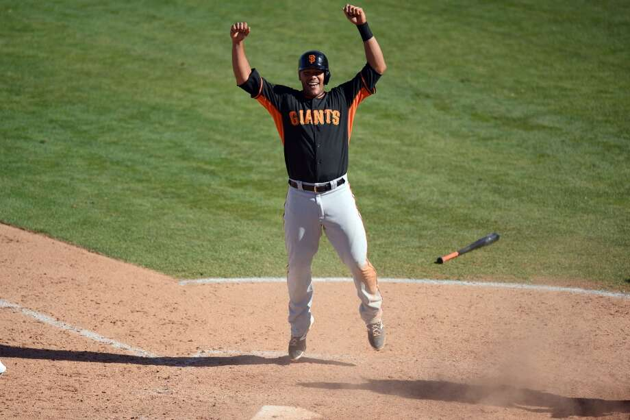 San Francisco Giants infielder Chris Dominguez (79) celebrates scoring a run in the ninth inning against the Los Angeles Angels at Tempe Diablo Stadium. The Angles won 8-7. Photo: Joe Camporeale, Reuters