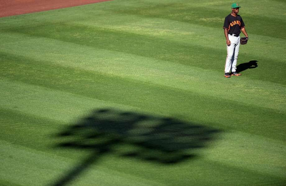 San Francisco Giants left fielder Chris Lofton (77) looks on against the Los Angeles Angels at Tempe Diablo Stadium. The Angles won 8-7. Photo: Joe Camporeale, Reuters