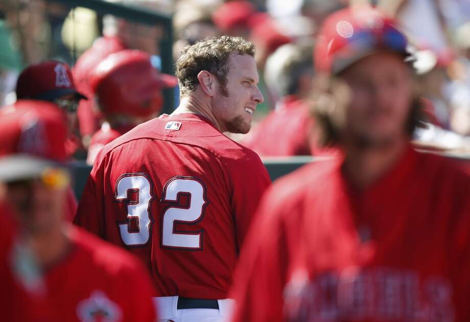 Los Angeles Angels' Josh Hamilton smiles in the dugout after scoring a run against the San Francisco Giants in the fourth inning of a spring training baseball game, Monday, March 17, 2014, in Tempe, Ariz.  The Angels defeated the Giants 8-7. Photo: Ross D. Franklin, Associated Press