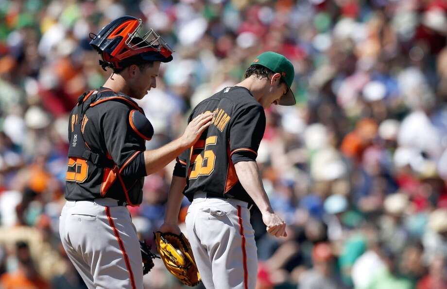 San Francisco Giants' Tim Lincecum, right, gets a visit from catcher Buster Posey in the fourth inning of a spring training baseball game against the Los Angeles Angels, Monday, March 17, 2014, in Tempe, Ariz. Photo: Ross D. Franklin, Associated Press