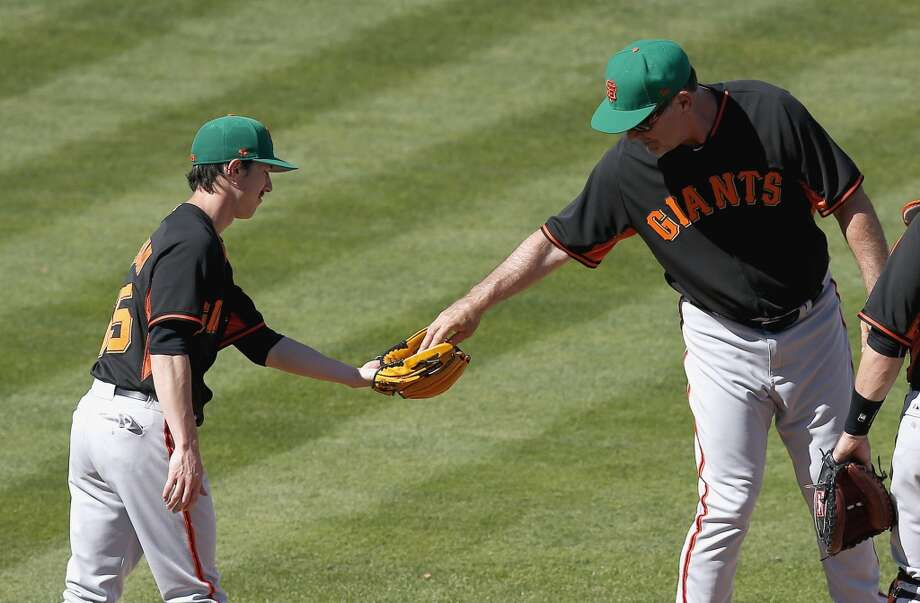 San Francisco Giants' Tim Lincecum, left, lets manager Bruce Bochy, right, take the ball from his glove after Lincecum is taken out of the game in the sixth inning of a spring training baseball game against the Los Angeles Angels, Monday, March 17, 2014, in Tempe, Ariz. Photo: Ross D. Franklin, Associated Press