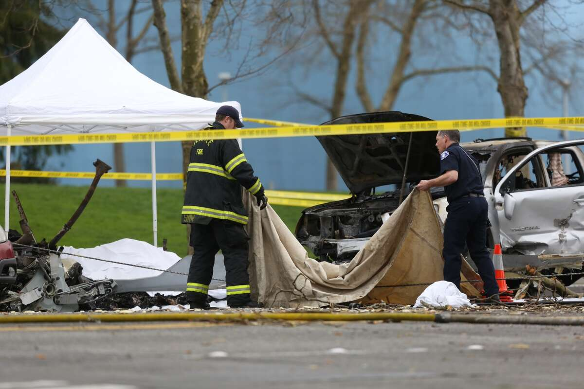 Seattle firefighters work the crash scene.