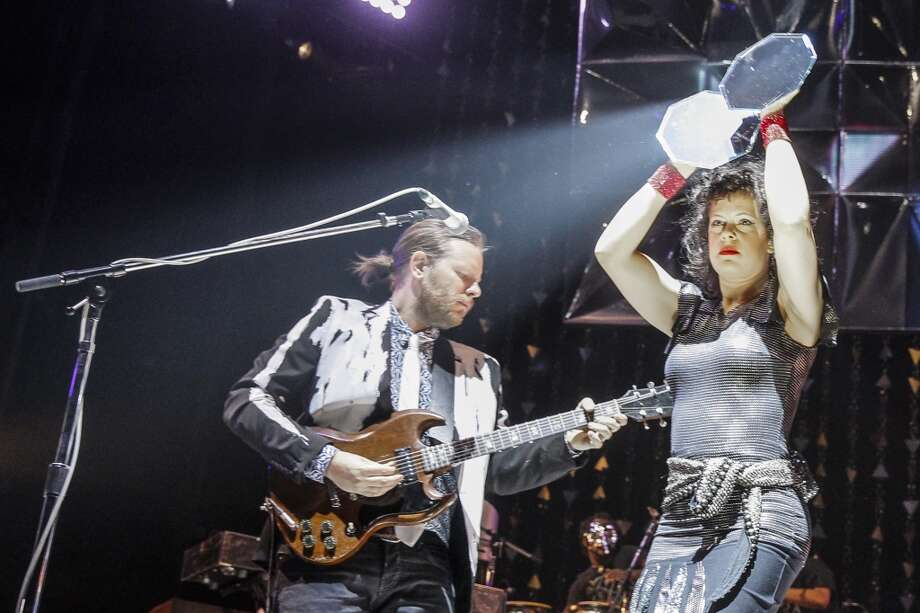OTTAWA, ON - MARCH 14:  Tim Kingsbury and Regine Chassagne perform live with Arcade Fire at the Canadian Tire Centre on March 14, 2014 in Ottawa, Canada.  (Photo by Mark Horton/WireImage) Photo: WireImage