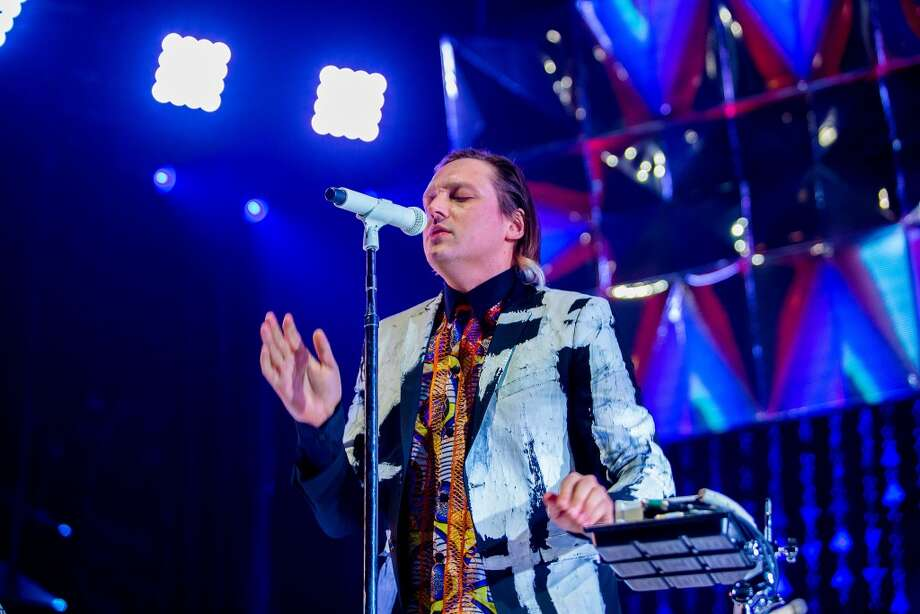 PHILADELPHIA, PA - MARCH 17: Win Butler of Arcade Fire performs at the Wells Fargo Center on March 17, 2014 in Philadelphia, Pennsylvania. (Photo by Jeff Fusco/Getty Images) Photo: Getty Images