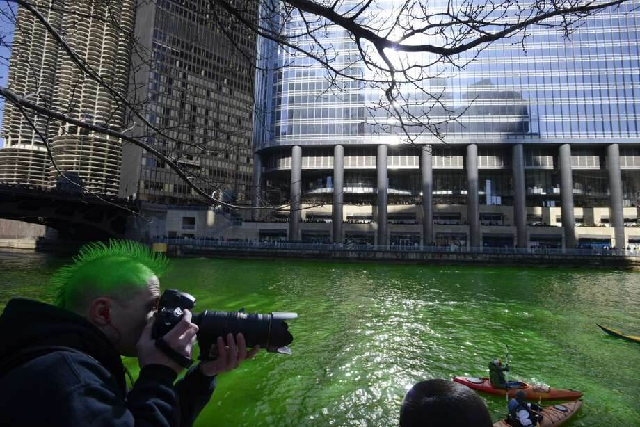 The Chicago River being dyed green ahead of the St. Patrick's Day parade in Chicago, Saturday, March 15, 2014. (AP Photo/Paul Beaty) Photo: Associated Press