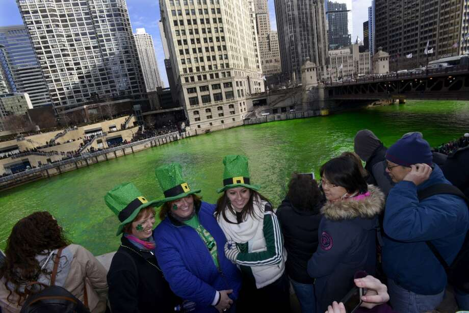 The Chicago River being dyed green ahead of the St. Patrick's Day parade in Chicago, Saturday, March 15, 2014. (AP Photo/ Paul Beaty) Photo: Associated Press