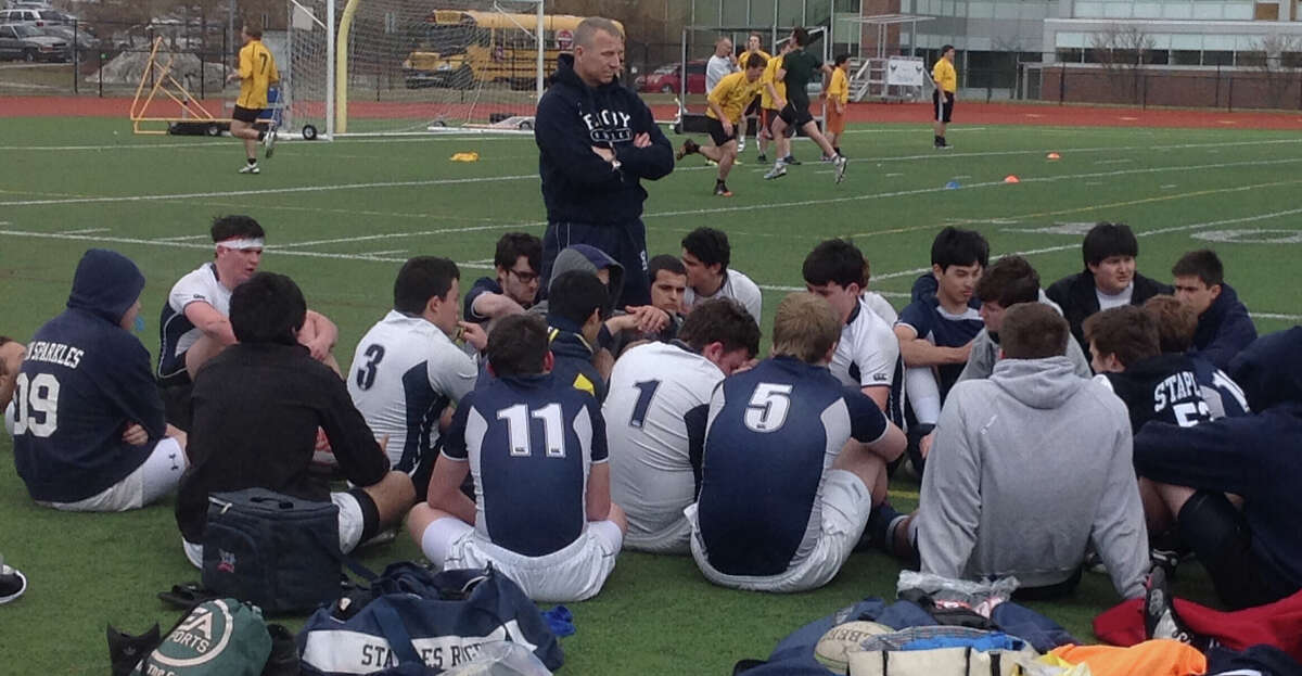 Staples High School Assistant Rugby Coach Randy Heller, center, addresses his team following scrimmage with Fairfield and Ridgefield on Saturday.