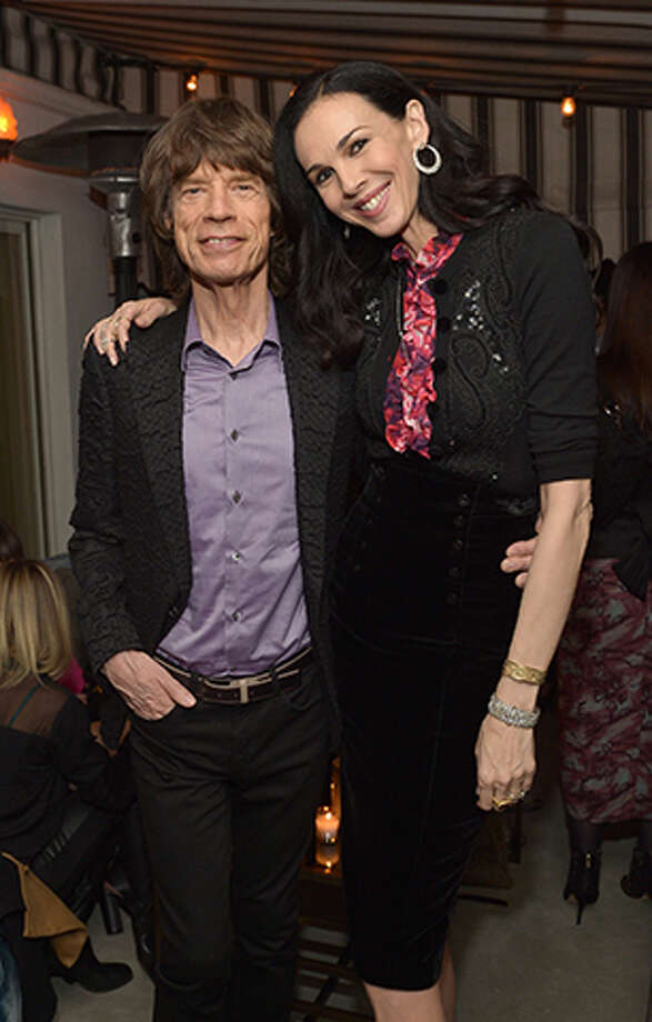 Mick Jagger and L'Wren Scottin 2013. / 2013 Getty Images