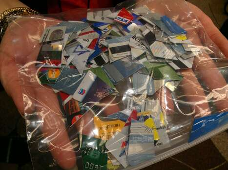 Shredded credit cards are called confetti in the lost and found office. Photo: Craig Hlavaty/Houston Chronicle