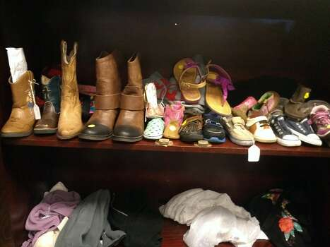 Lost shoes end up here. Where are their mates? Photo: Craig Hlavaty/Houston Chronicle