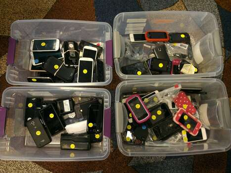 Cellphones of every brand can be seen. Nice Hello Kitty case, whoever you are. Photo: Craig Hlavaty/Houston Chronicle