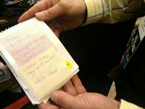 A fellow newsman has lost his notes. Photo: Craig Hlavaty/Houston Chronicle