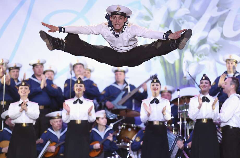 Whoopee Russians: Russian Black Sea fleet dancers and musicians perform for a pro-Russian crowd at Lenin's Square in Simferopol, Ukraine. On Tuesday, Russian President Vladimir Putin signed a treaty to annex Crimea. Photo: Max Vetrov, Associated Press