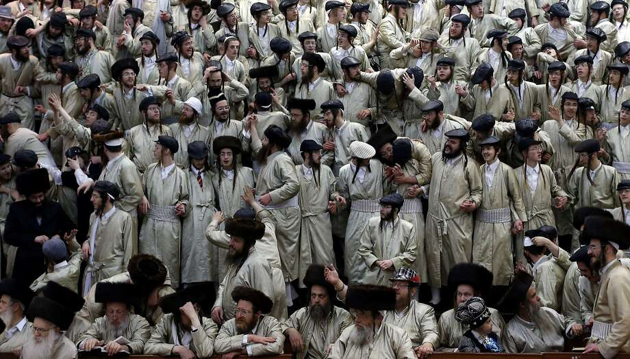 Partying for Purim: Ultra-Orthodox Jewish men celebrate Purim in the Mea Shearim neighborhood of Jerusalem. The carnival-like holiday is marked by parades, costume parties and drinking wine to commemorate the deliverance of the Jews from a Persian plot to exterminate them 2,500 years ago, as recorded in the Biblical Book of Esther. Photo: Thomas Coex, AFP/Getty Images