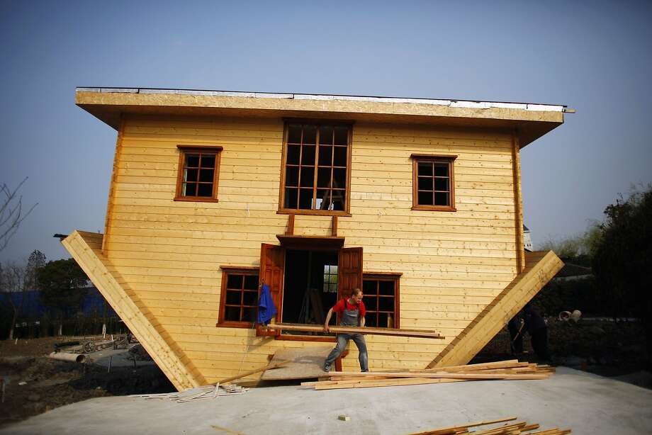 "We fired the architect:The""blueprints were upside-down"" joke never gets old at Fengjing Ancient Town, in China's Jinshan District, where workers were putting the final touches on this inverted abode. Furnishings inside the whimsical house will also be installed upside-down. Photo: Carlos Barria, Reuters"